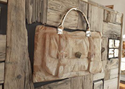 Mosaico con valigia